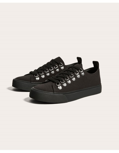 BLACK PLIMSOLLS WITH EYELETS DETAIL