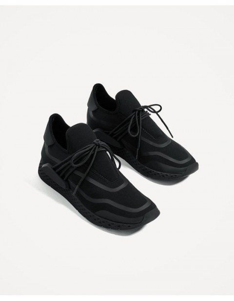BLACK SNEAKERS WITH SIDE PIECES
